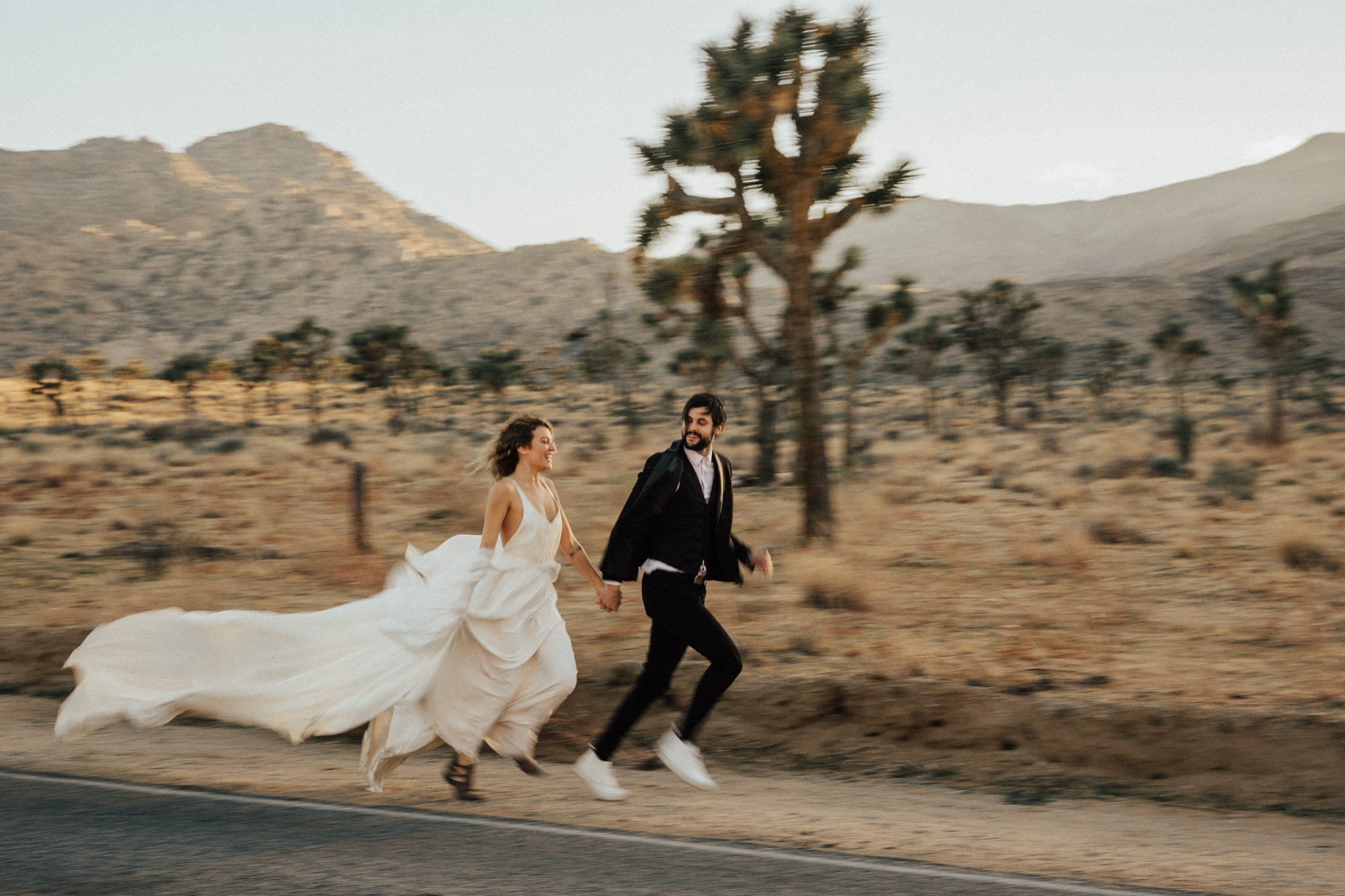 couple running in joshua tree