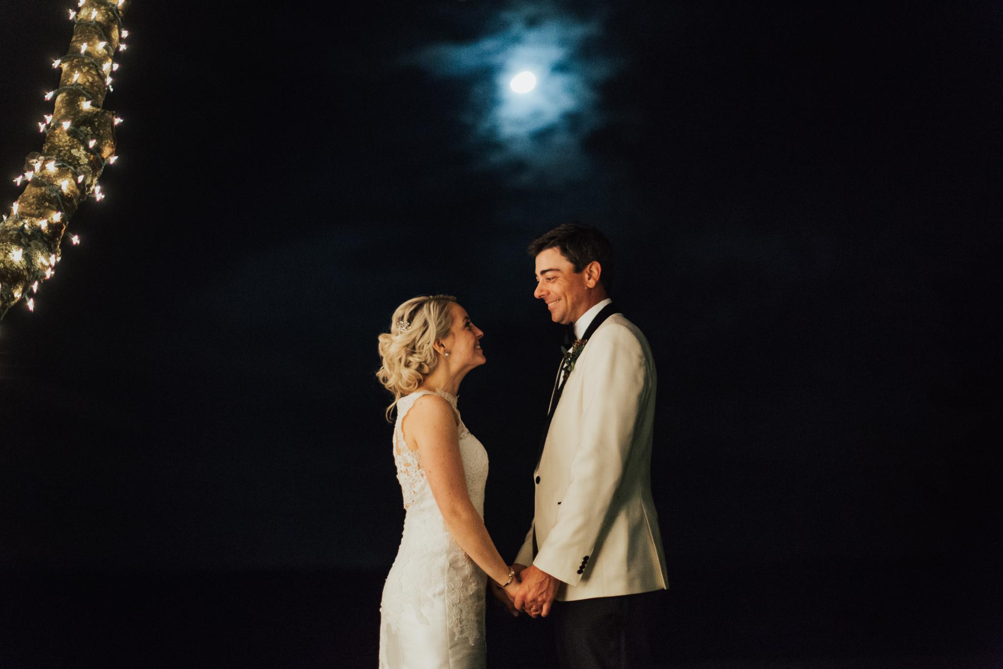 bride and groom under moonlight