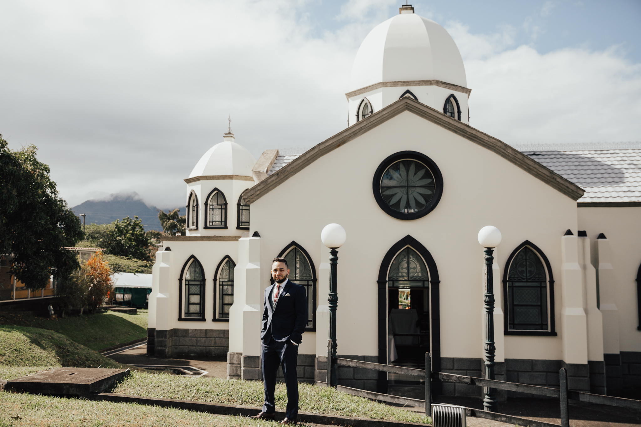 groom in front of church