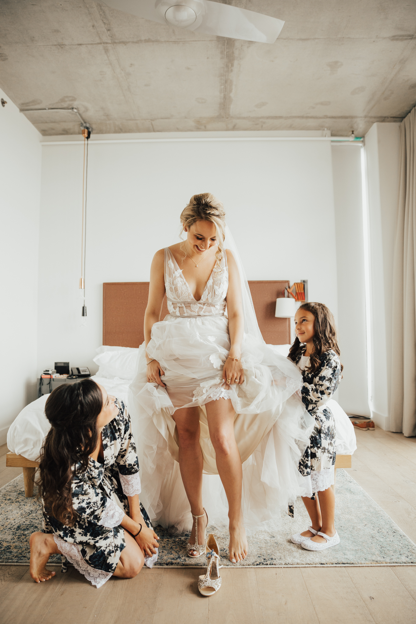 flower girl helping bride
