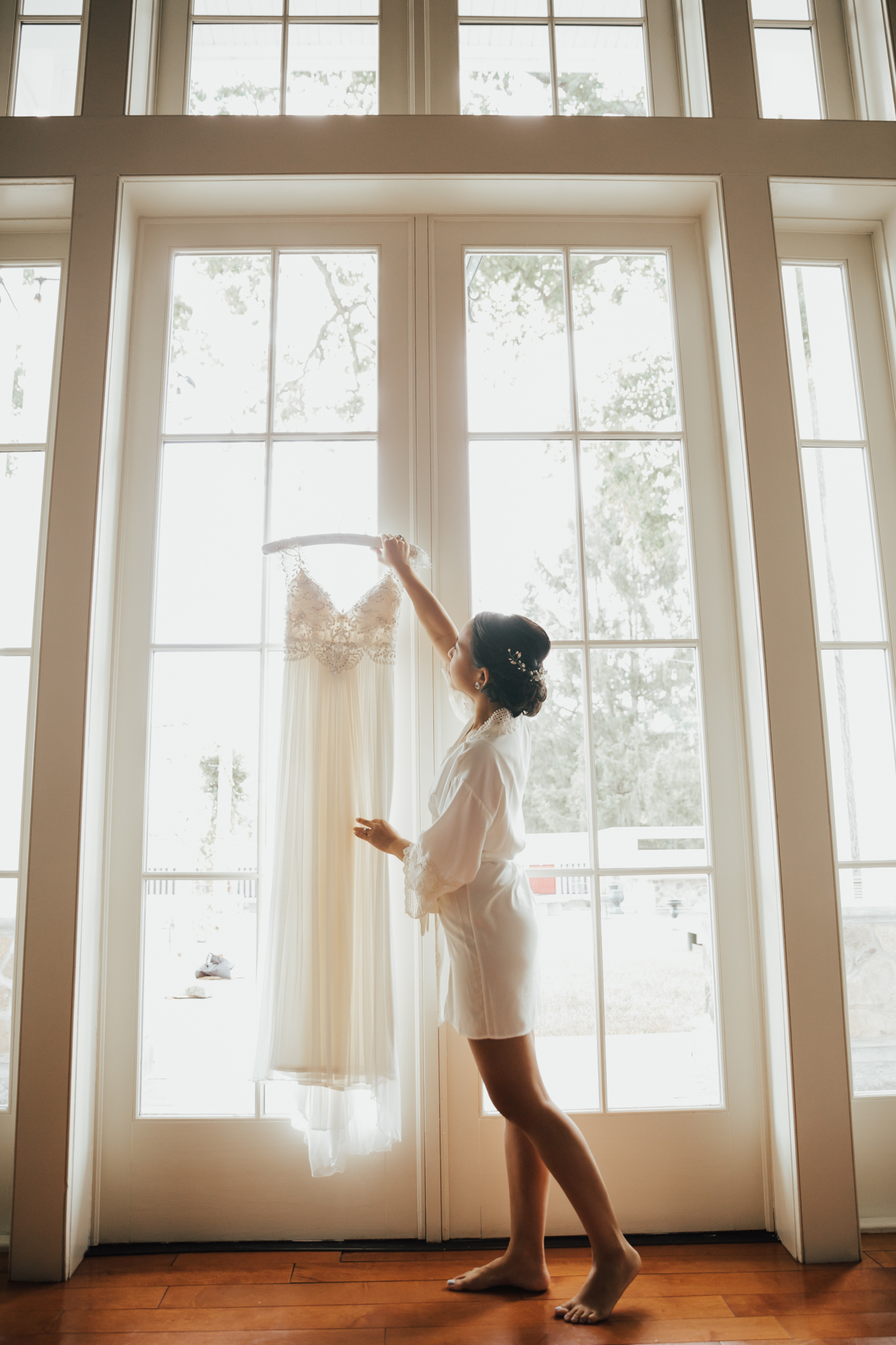 bride with wedding dress getting ready