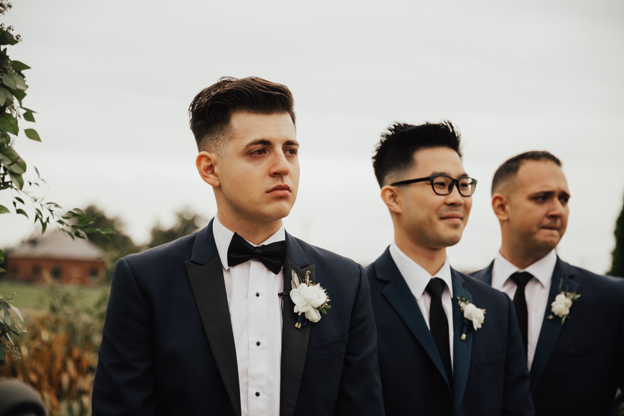 crying groom at alter