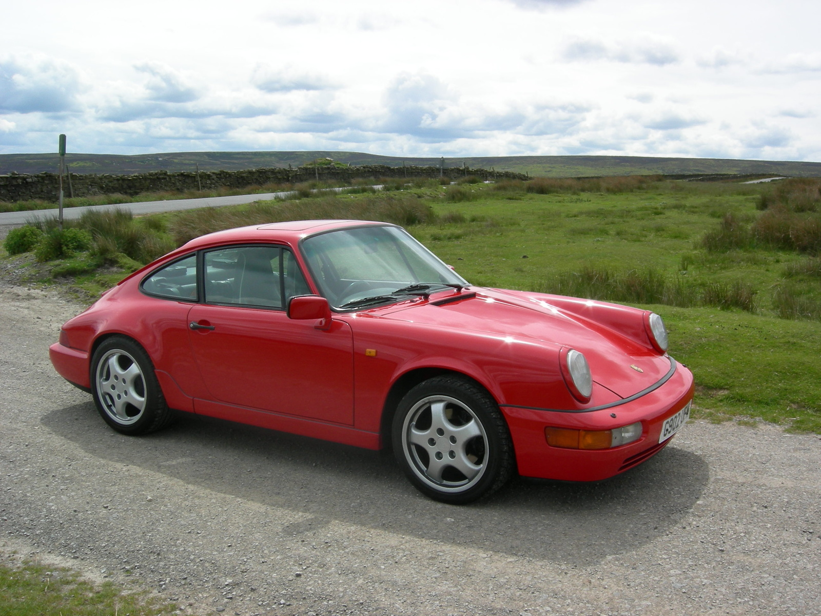The donor vehicle is a 1990 Carrera 4 AWD in Guards Red. An original Australian car with 143,000 kilometres.