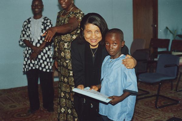 Pastor Rosetta Cox with student