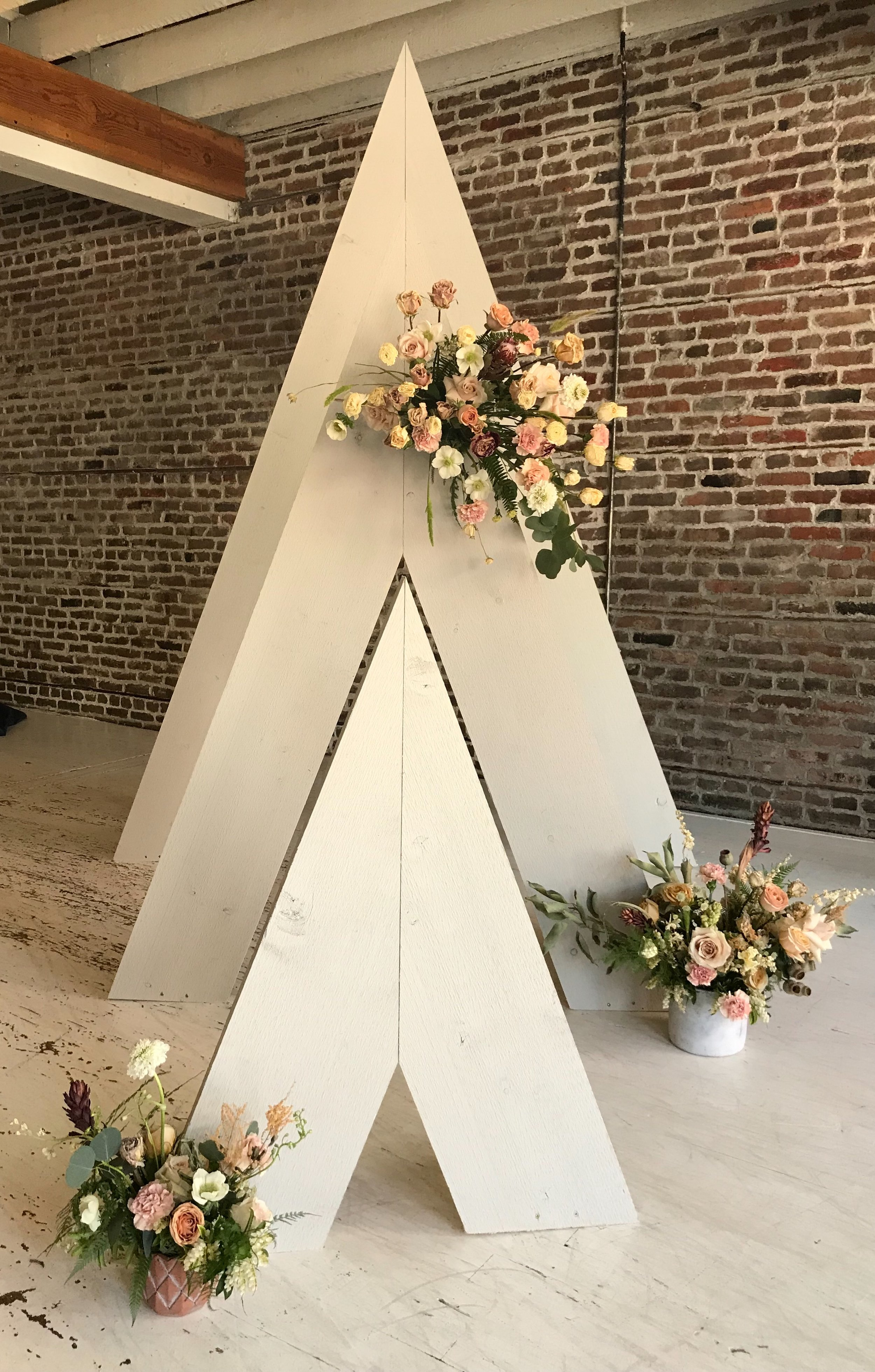 white wood triangle arch - 3 pieces   Quantity: 1  Price: $175.00