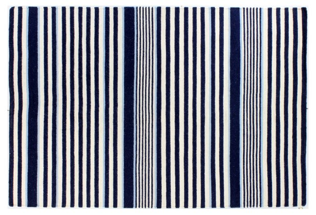 Striped navy area rug