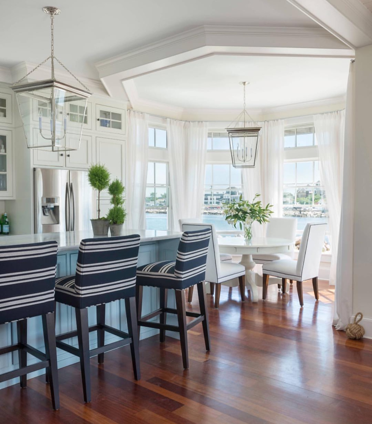 Coastal White Kitchen and Dining Room with navy accents