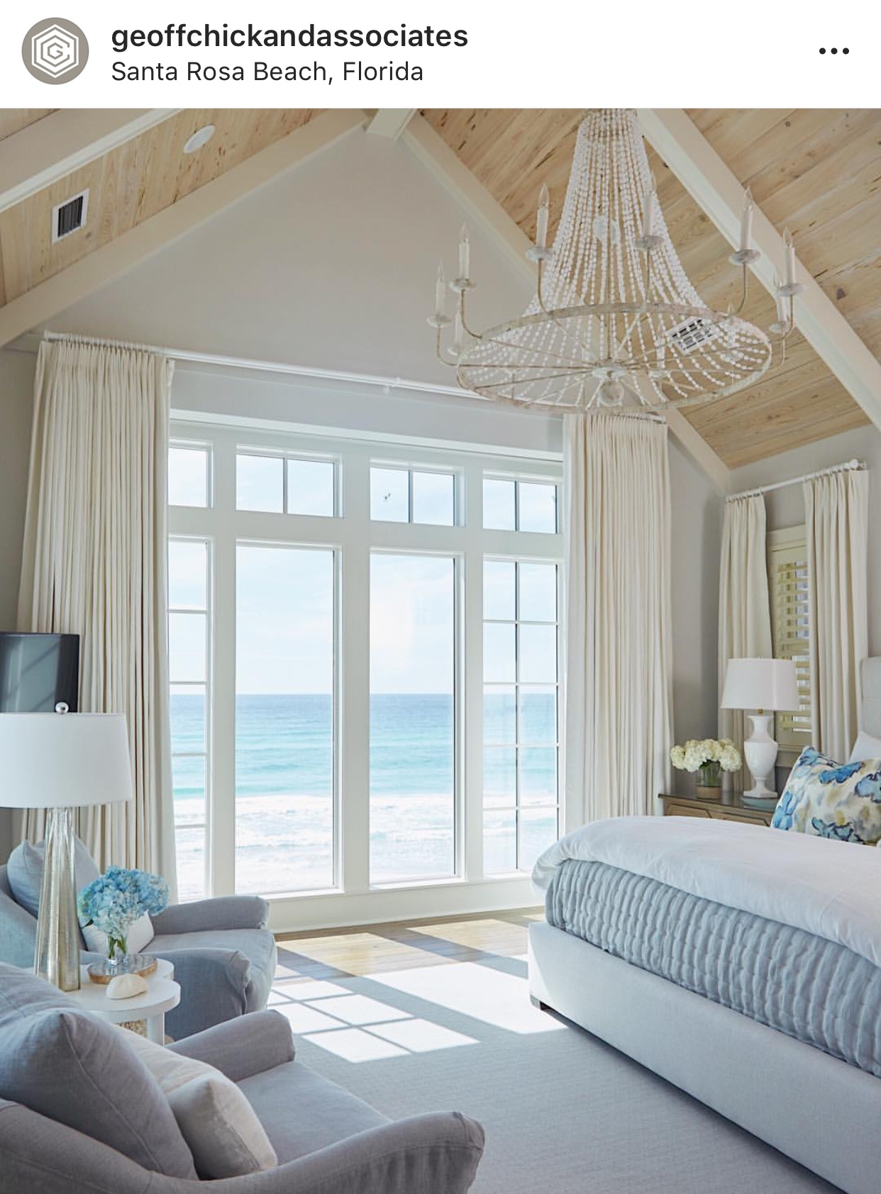 Coastal Interiors Master Bedroom with Vaulted Natural Wood Ceilings and White Beams