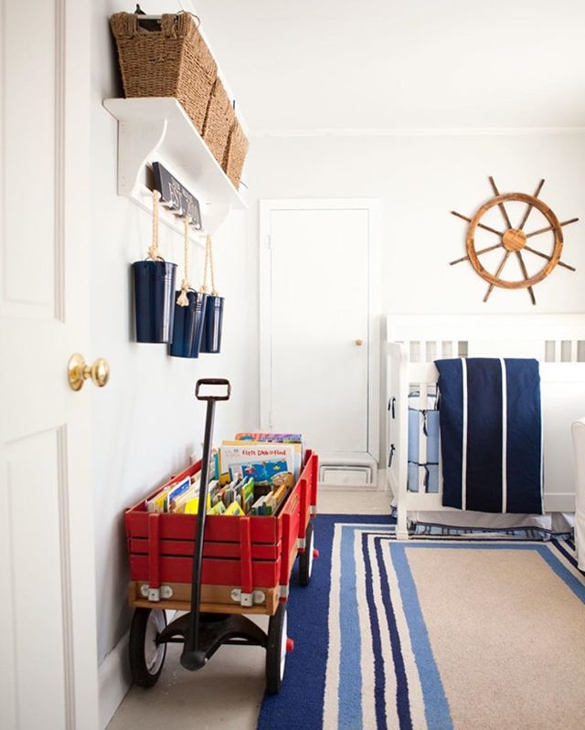 "A dose of nautical in this kiddo's room! ⚓️🌊 I LOVE the red wagon book storage too!!😍 . via: Tess Fine Photography and Jen of @migonishome ⬅️ . Remember to ""Like""❤️, Save, and Share so I know what you want to see more of!🙌🏻😄"