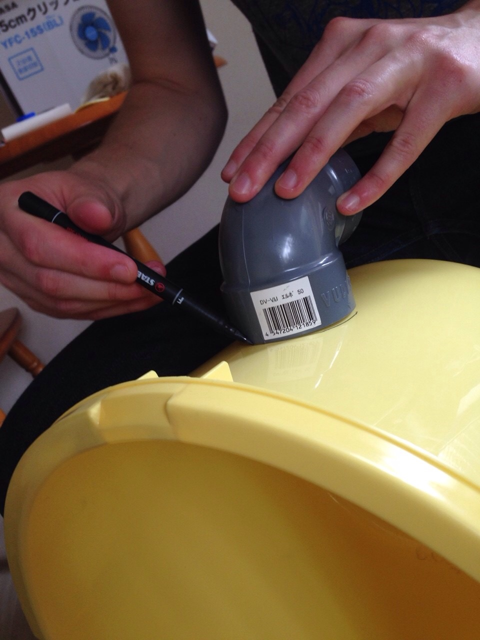 Next trace the shape of your PVC elbows on the sides of the bucket.