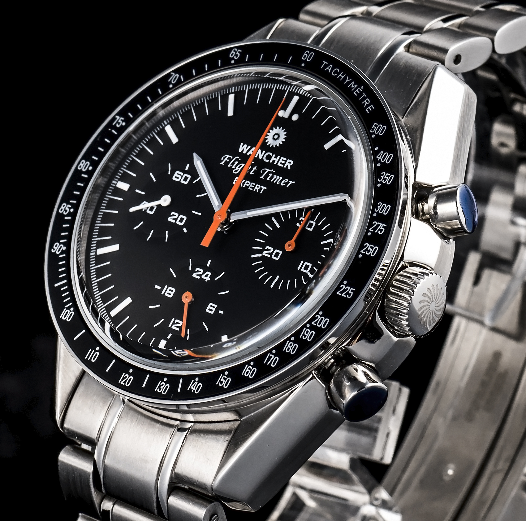 TACHYMETER - A tachymeter is a useful scale for computing speed based on travel time over a fixed distance travelled, which can be found on a watch's bezel or running around the outside of the dial. Or in other words, it is simply a means of converting elapsed time (in seconds per unit) to speed (in units per hour).