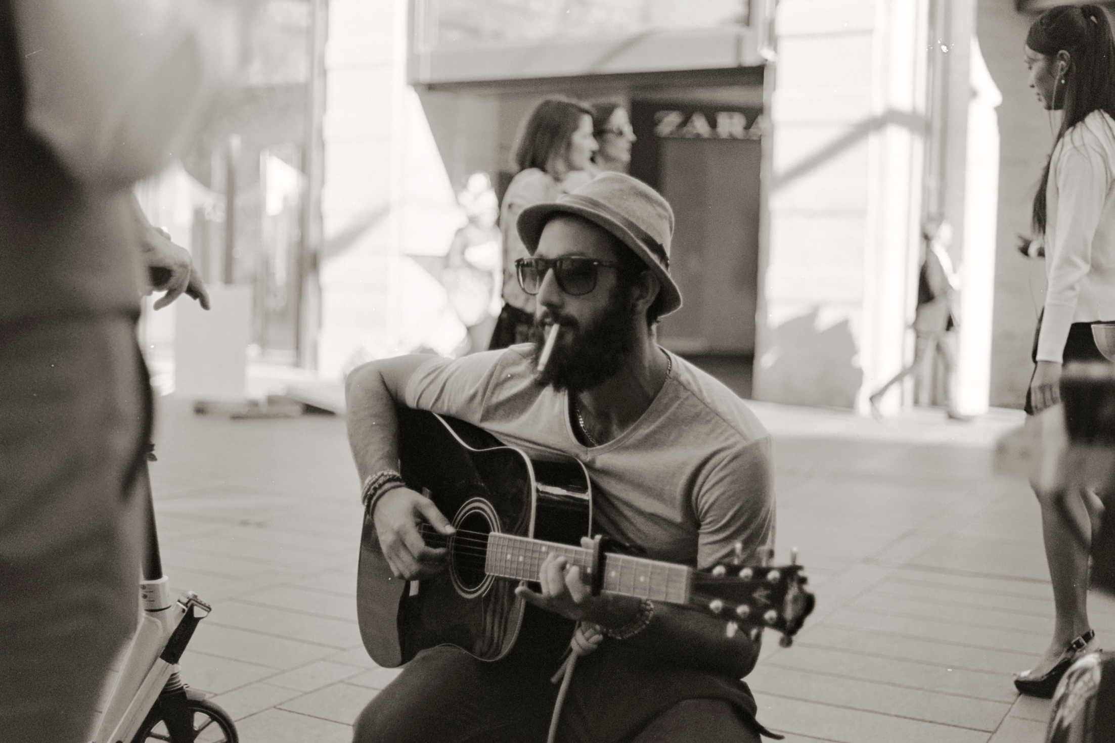 Guillaume playing my guitar between customers.