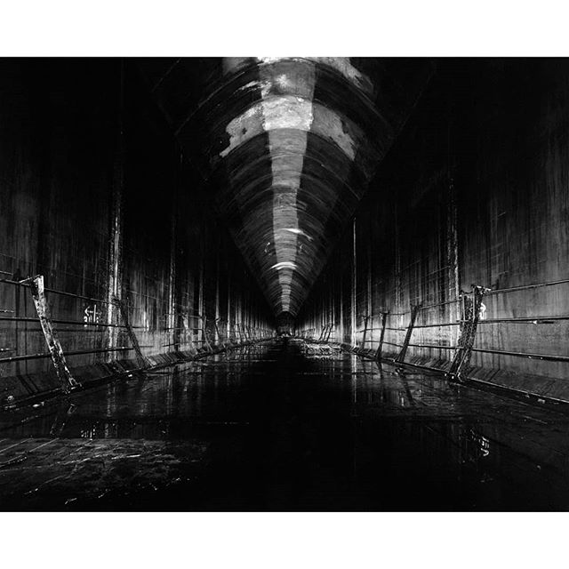 Scan of the negative from One Shot: Inchindown (formerly known as Tanky McOneshot). I created this with @srfilmphotography in the Inchindown oil facility in the Scottish Highlands.  We limited ourselves to only one attempt at getting this shot, and then developed and printed it on location, in the underground service tunnels. The final print is on gelatin silver fiber paper, measuring 120cm wide.  Look for the full documentary to be released in September! For more info see the link in bio.  A very special thanks to @intrepidcamera  @patersonphoto  @coolfilmclub  @sunny16podcast  @35mmcblog  @emulsivefilm  @tetenaldarkroomexperts  @camerafilmphotohk @gofundme And everyone who has supported the project on GoFundMe ! . . . #beliveinfilm #heylomography #ilfordphoto #ilfordhp5 #analogfeatures #analogphotography #sunny16podcast #buyfilmnotmegapixels #largeformat #largeformatcamera #blackandwhite #urbex #wwii #scotland #heyfsc #analogforever #beniceshootfilm #shootonfilm