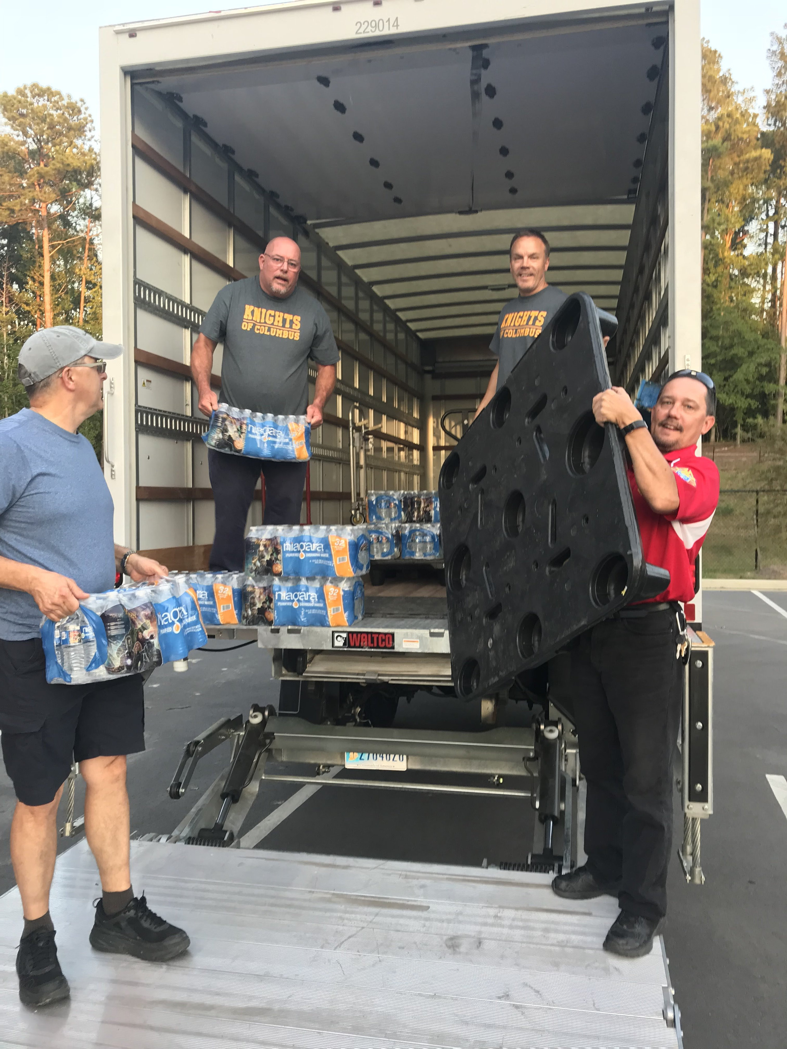 Council 7186 Grand Knight Tom Blum and NC State Advocate Chris Losack (Council 7186 member) help load a truck of supplies.
