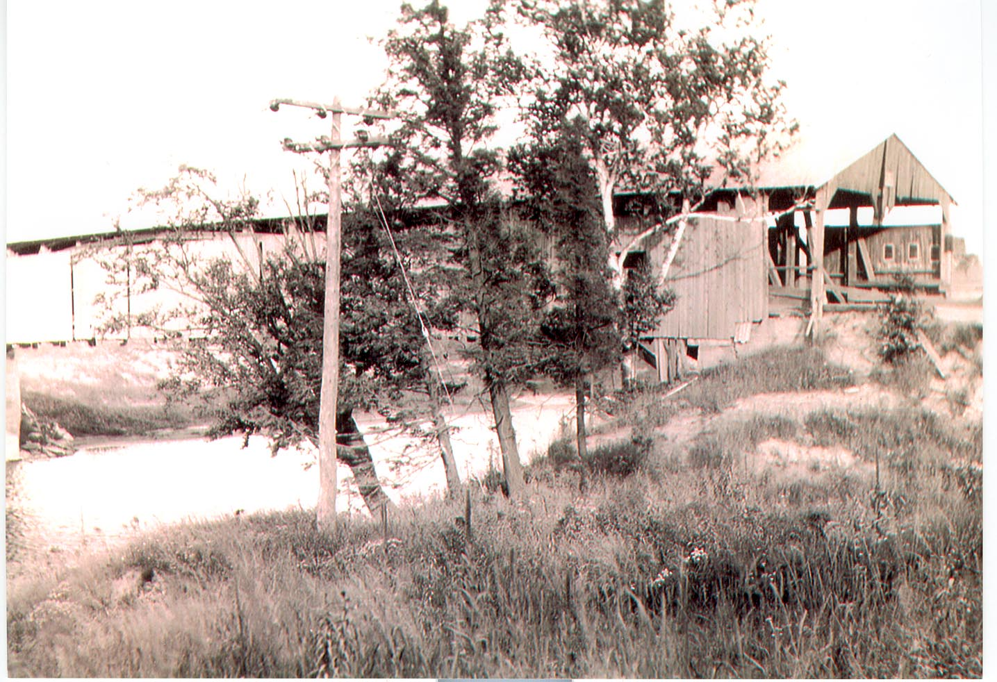 "The Winooski River damaged the ""Checkered House Bridge"" on Rt. 2 during the historic flood of 1927."