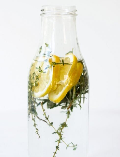 Lemon, Thyme, and Rosemary Infused Water - Talk about upping your lemon water game! Serve in a wine glass to make yourself feel extra fancy. Room temp, never iced - of course.