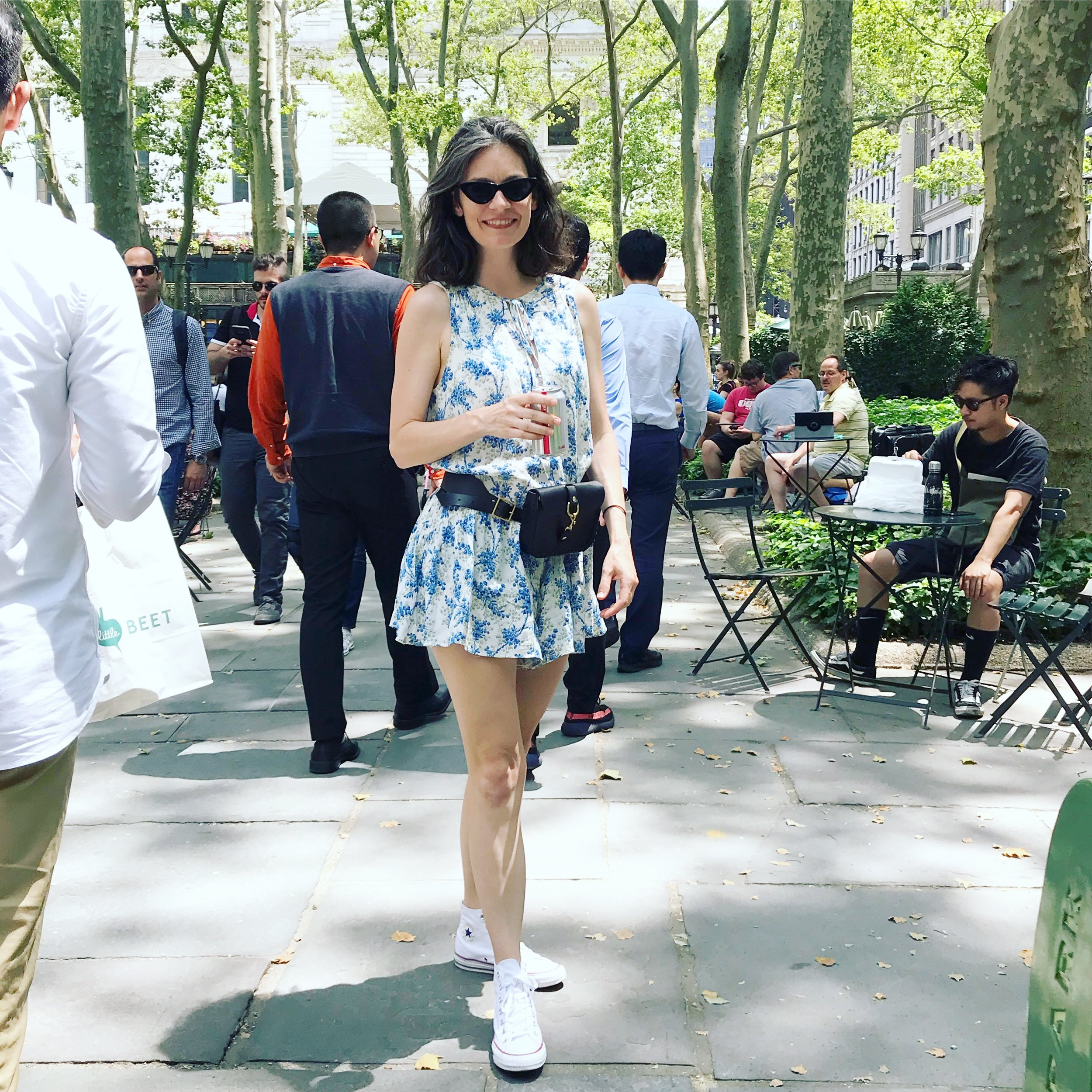 black leather belt bag by mary savel in Bryant park in new york city enjoying being hand free