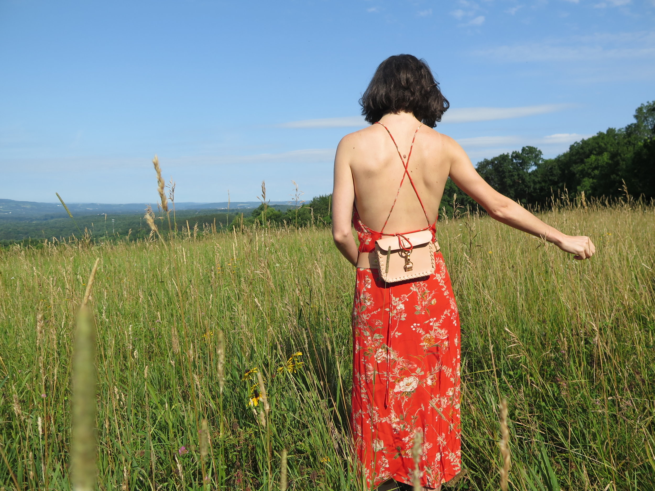 Leather belt bag by mary savel in nude in a country field.JPG