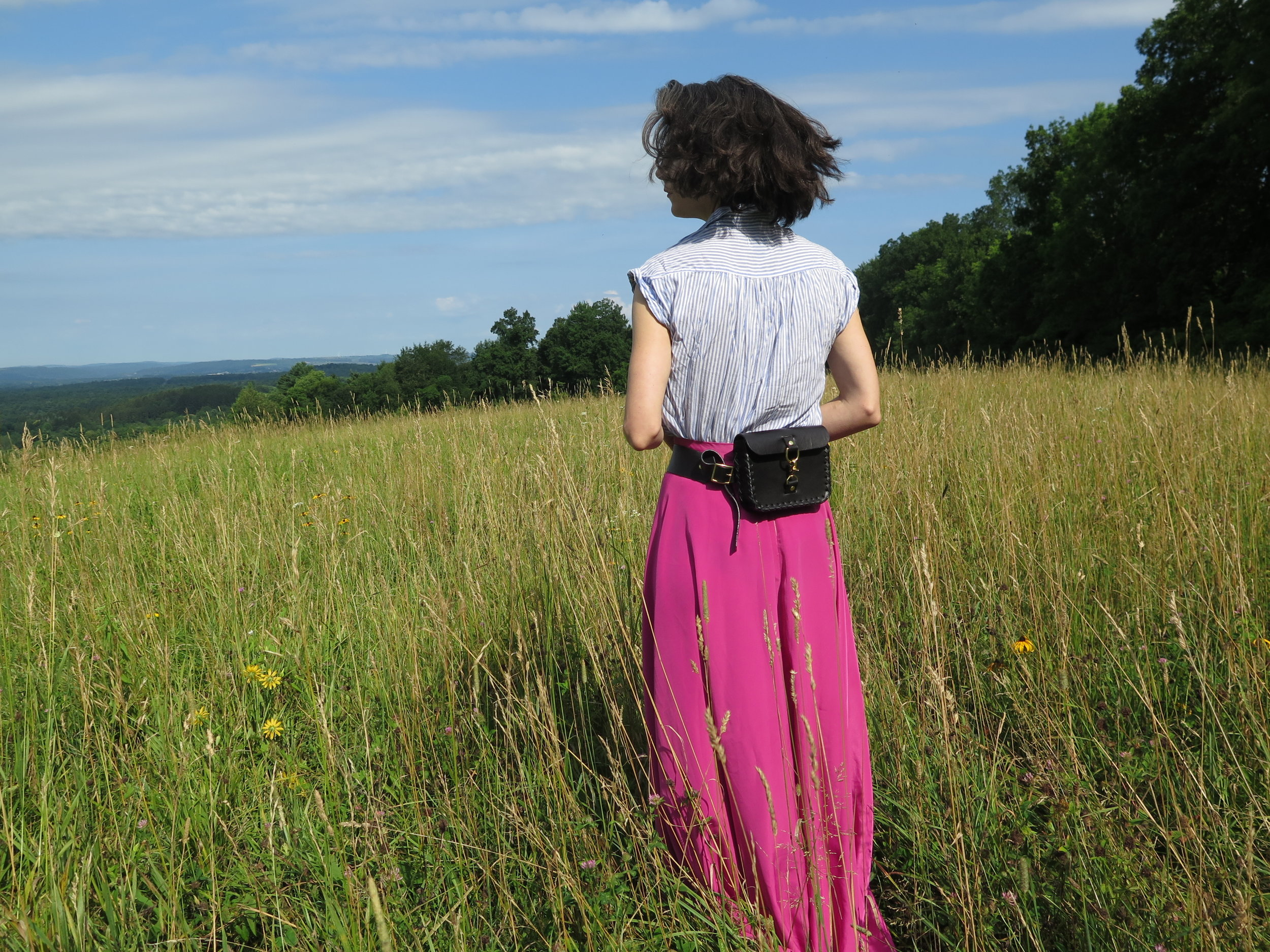 leather belt bag in black by mary savel in a country field 2.JPG