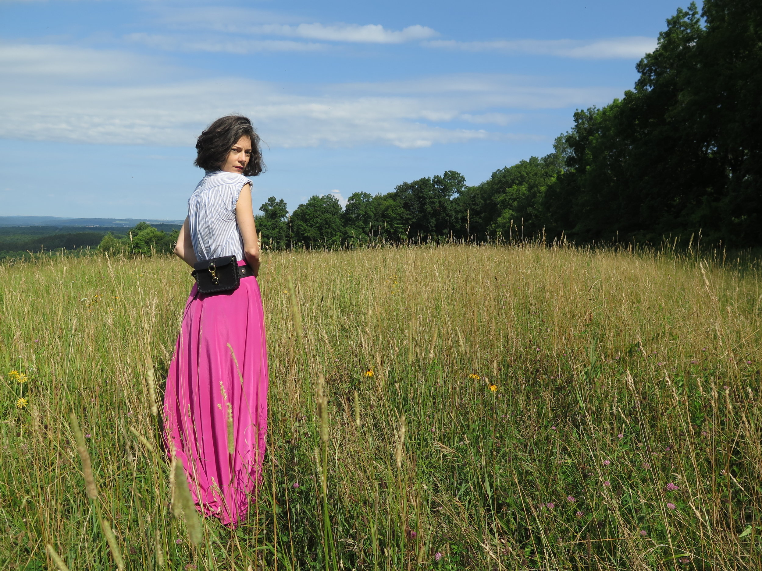 leather belt bag in black by mary savel in a country field.JPG