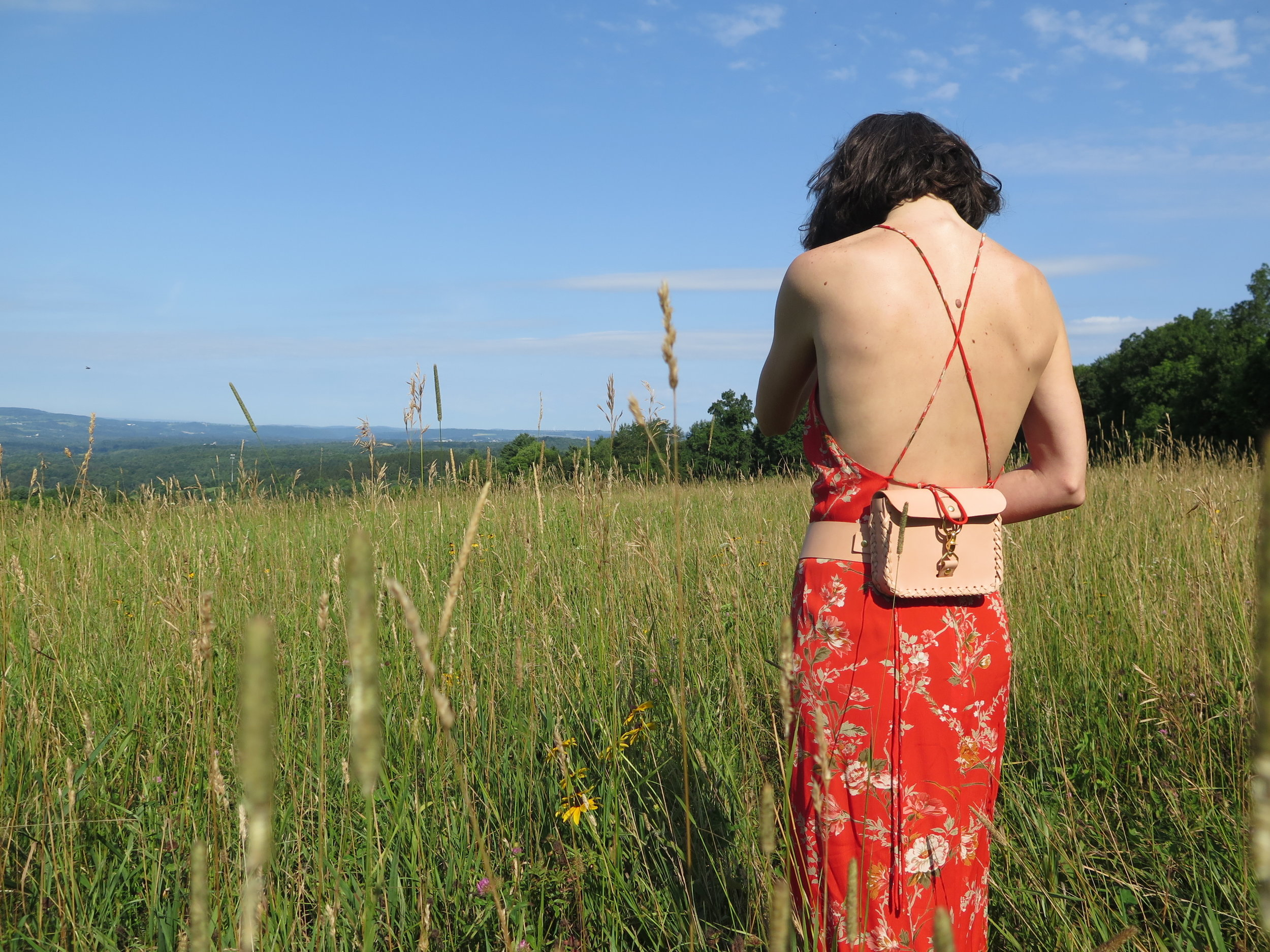 leather belt bag in nude by mary savel in a country field 7.JPG