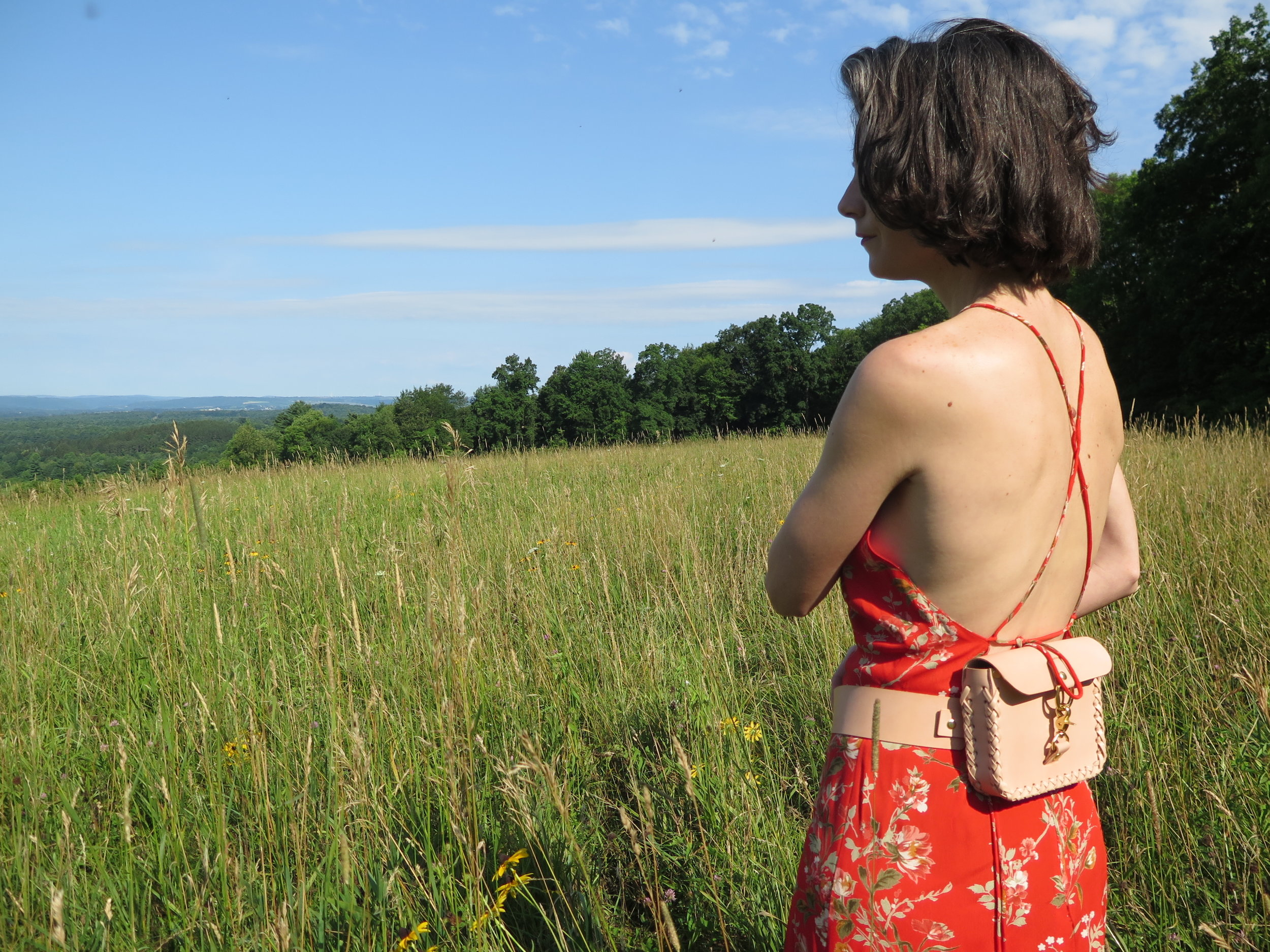 leather belt bag in nude by mary savel in a country field.JPG