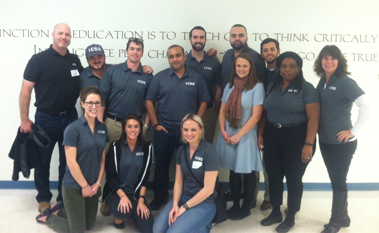 The group of HESS employees that volunteered their time to teach students the JA Economics for Success® program at Ridgeview Middle School on February 8, 2016.