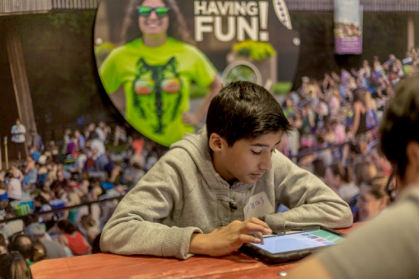 A student works through the financial literacy curriculum, learning about how arts and entertainment fits into his budget.