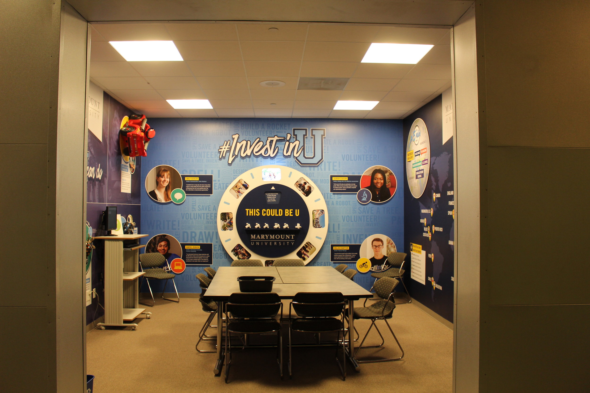 Part of a three-year partnership with Junior Achievement, Marymount's storefront encourages students to #InvestinU. To give the middle schoolers a glimpse of the types of work they can expect to do as college students, three-dimensional elements from Marymount student projects are affixed to a wall