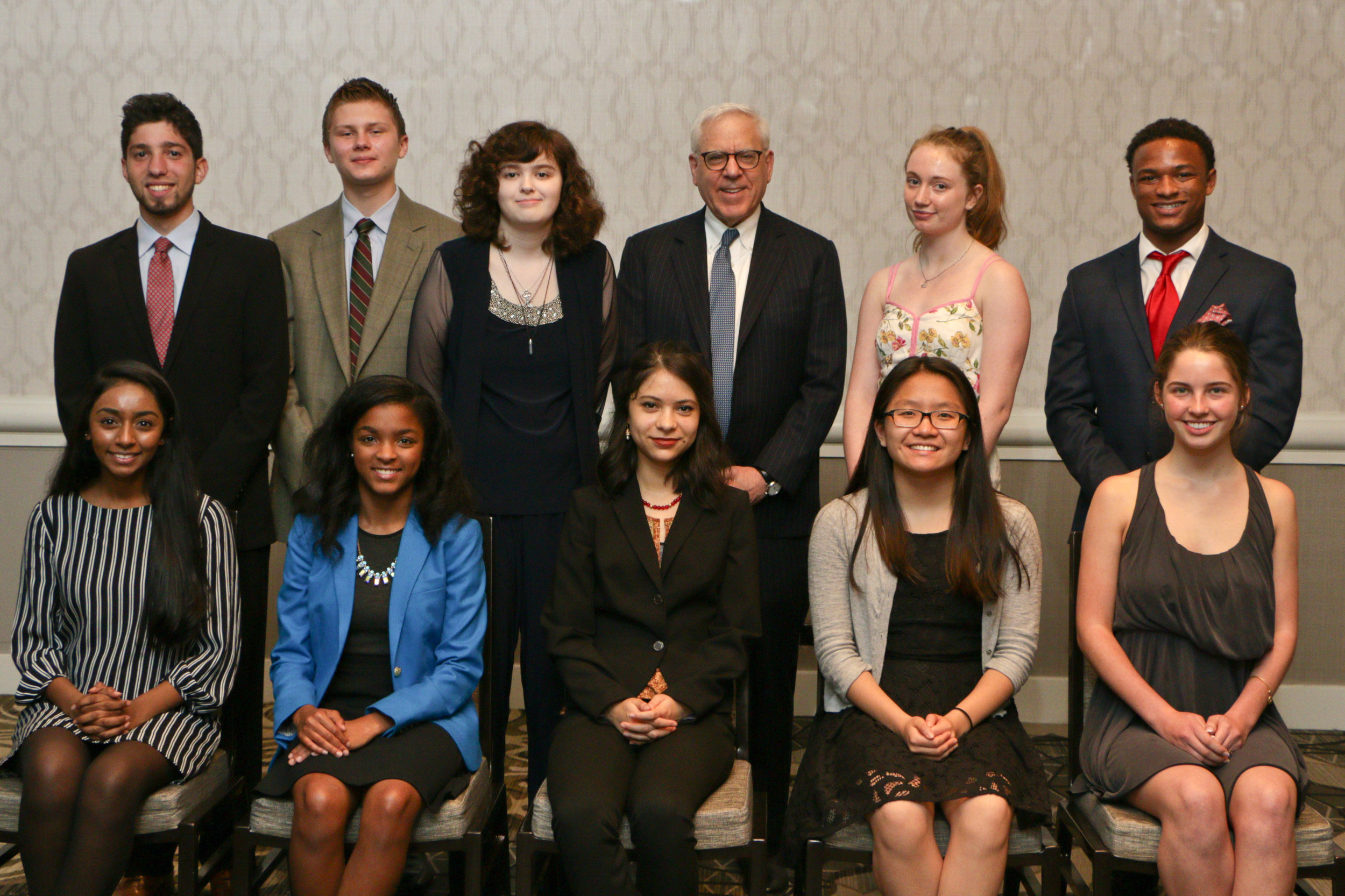 Back row from left: Isaac Frumkin, Matthew Evenson, Cara Schultz, Competition sponsor David M. Rubenstein, Emilia Majersik, and Mike Grimes. Front row from left: Fariha Bablu, Zoree Jones, grand prize winner Riya Ashby, Amanda Liu, and Emily Stein.