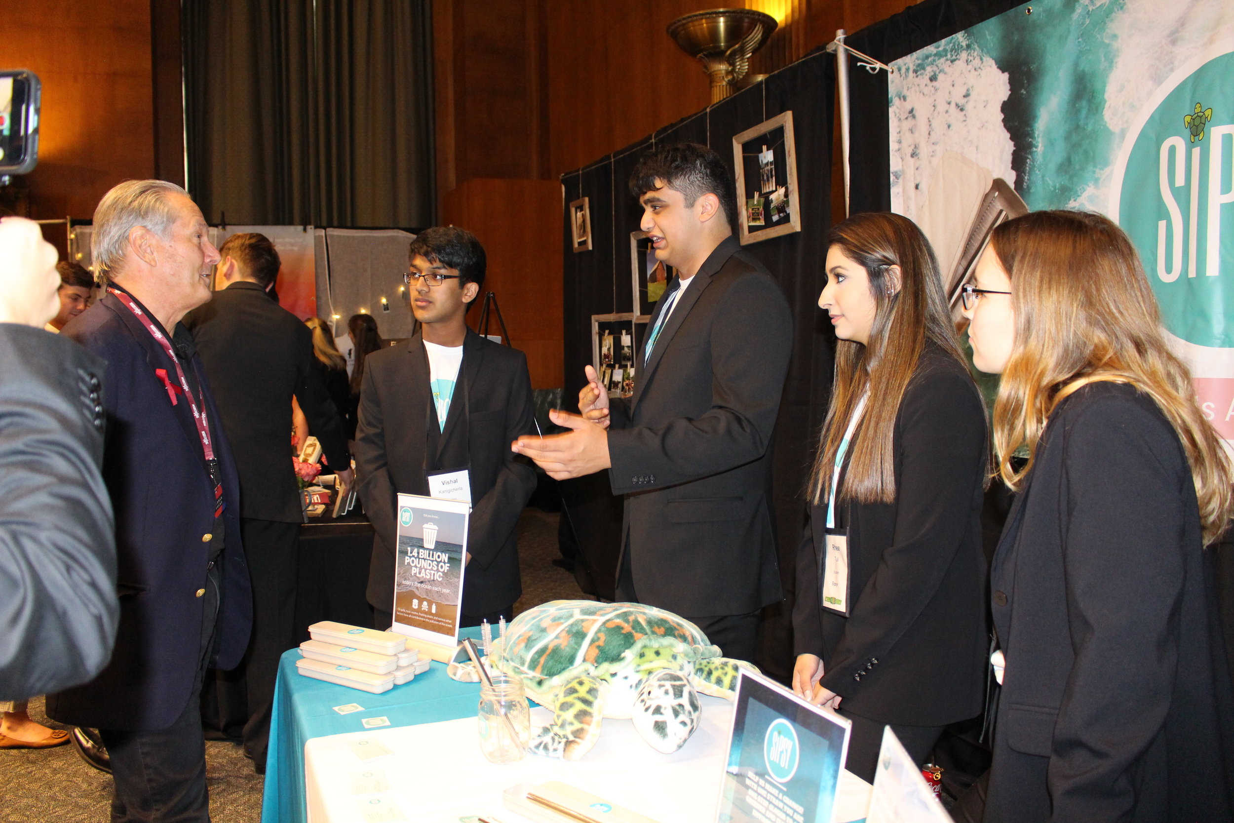 Team Sispy demonstrates their product at the Student Expo in the Dirksen Senate Office Builiding, as part of NSLS.