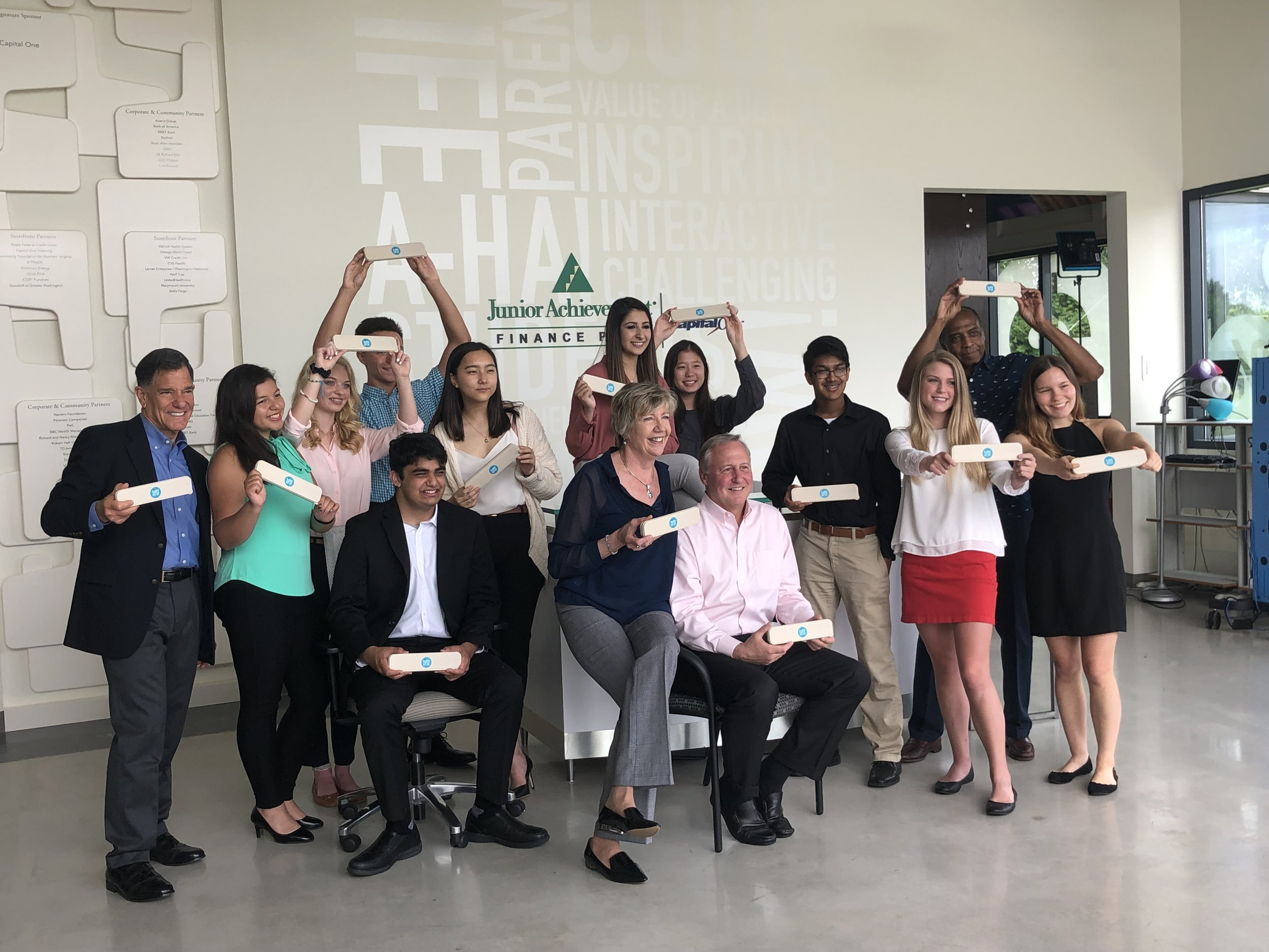 Team Sipsy and their volunteer mentors pose during a shoot with Northern Virginia Magazine.