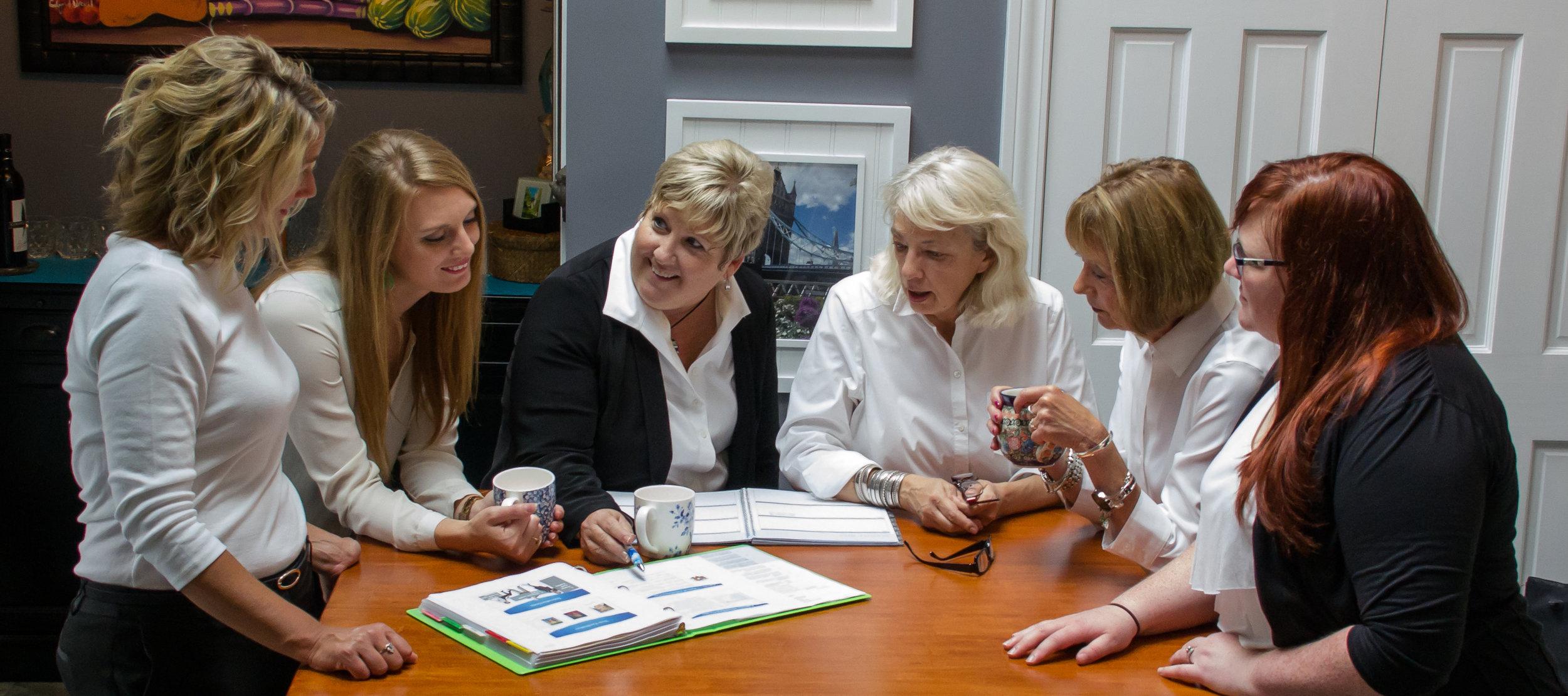 The Dau Consulting Team Leaning In (L-R): Andrea Applegate, Jade Smith, Jeanne Dau, Ann Beck, Jill Nilsen and Rachel Berg