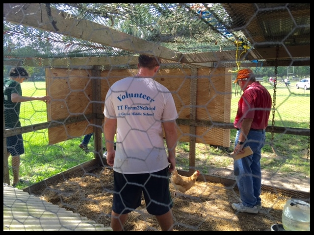 Gerry Curts directs the rebuilding of the chicken coop with help from Dylan.