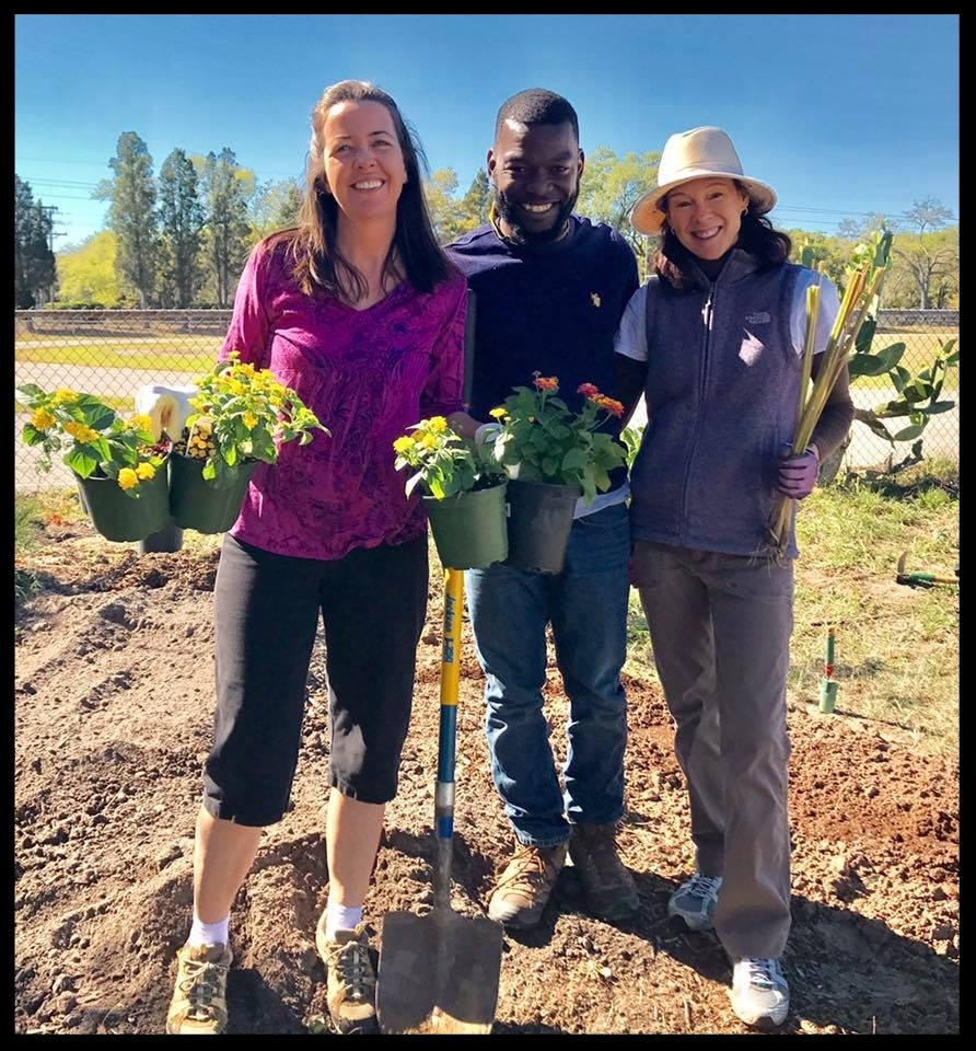 Kelly, Jacques Werleigh and Beth Bosserman-Curts working in the Greco Pollinator Garden.
