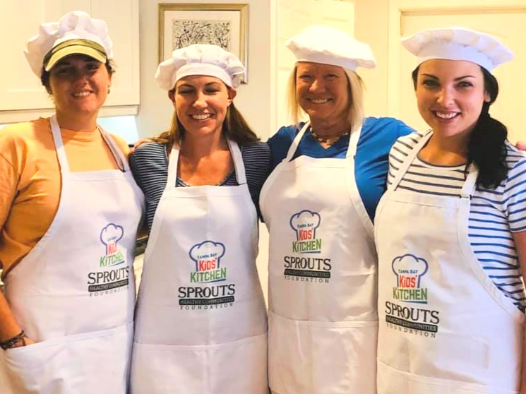 May 2019: Kids' Kitchen Cooking Team Brandi Murphy, Julie Cornwell, Elizabeth Leib and gabby Belcastro prepare for the summer Boys and Girls Cooking club.
