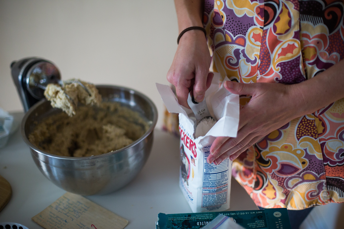 5.Siobhan and her mother slowly mix in the flour through a two-step process. First, add 2 cups all-purpose flour into the bowl and blend. Once incorporated, add the remainder 1 1/3 cups flour until a soft mealy dough forms.