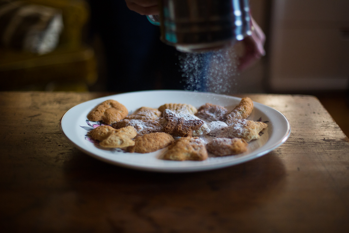 To plate, arrange cookies on a plate and liberally sift confectioners sugar to your heart's desire.