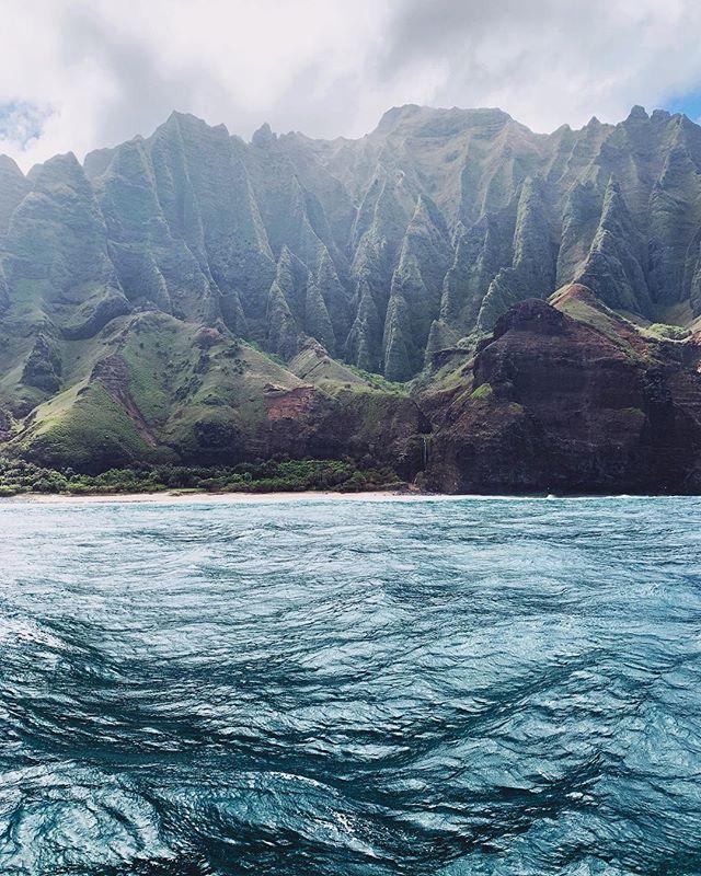 I'm on a boat, again. ⛵️🌊⛰⛰🌊
