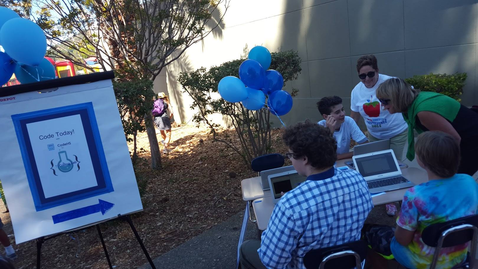 Coding at the Carnival! TL Coding Lab student mentor shows coding to Mary Jane Burke, Superintendent of School, MOE and Rachel Kertz, President, San Rafael City School Board of Trustees at Summerfest Carnival 2015 sponsored by HeadsUp Foundation to raise funds for enrichment K-12..