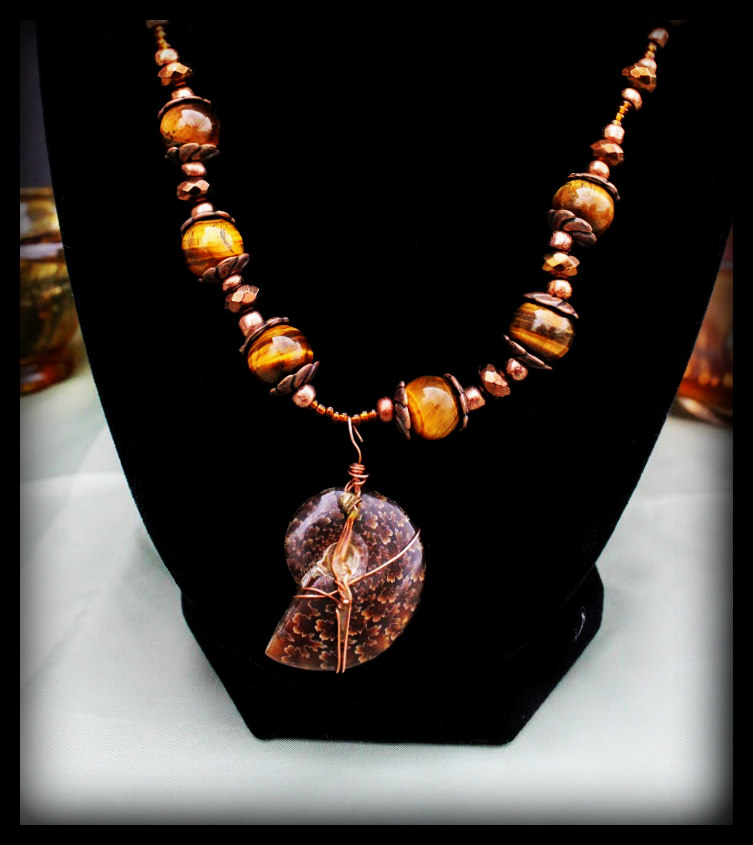 Necklace  $35 Eddie Raines Copper, beads, and fossilized ammonite