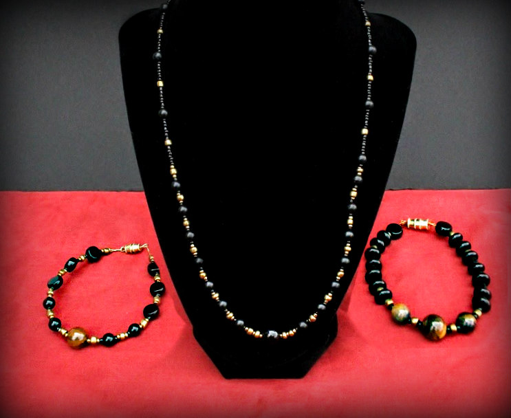Necklace and bracelet $35 Eddie Raines Glass and tiger eye