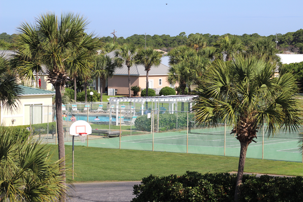 Recreation area around the clubhouse featuring 2 tennis courts, basketball, shuffleboard and plenty of green space.