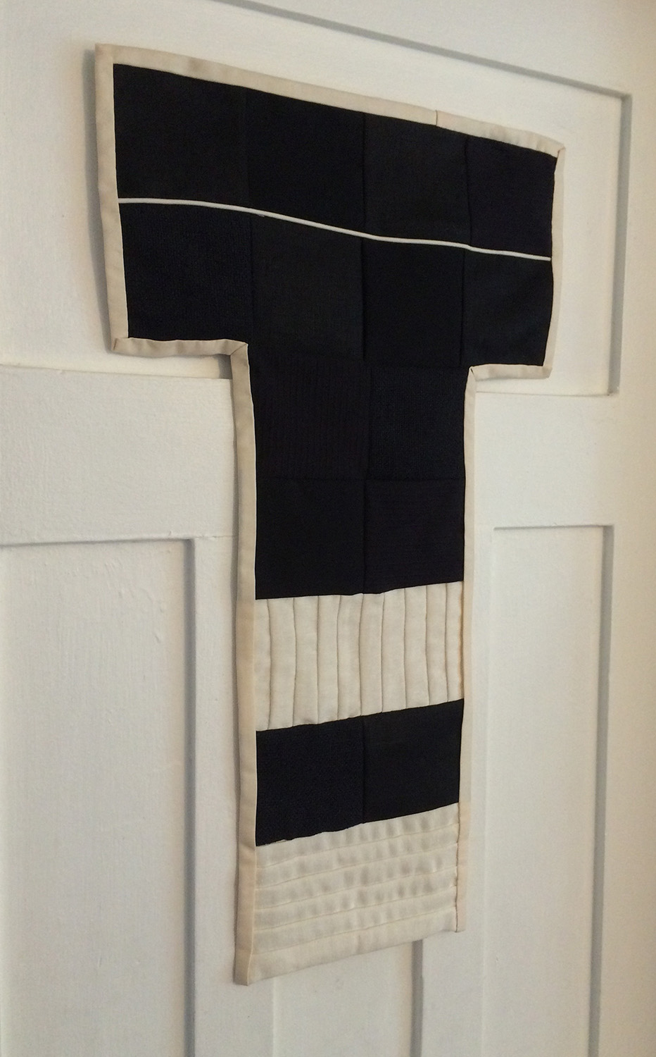 A black and white composition of pleats and quilted squares.  Going to The Frye Museum Store in Seattle, WA