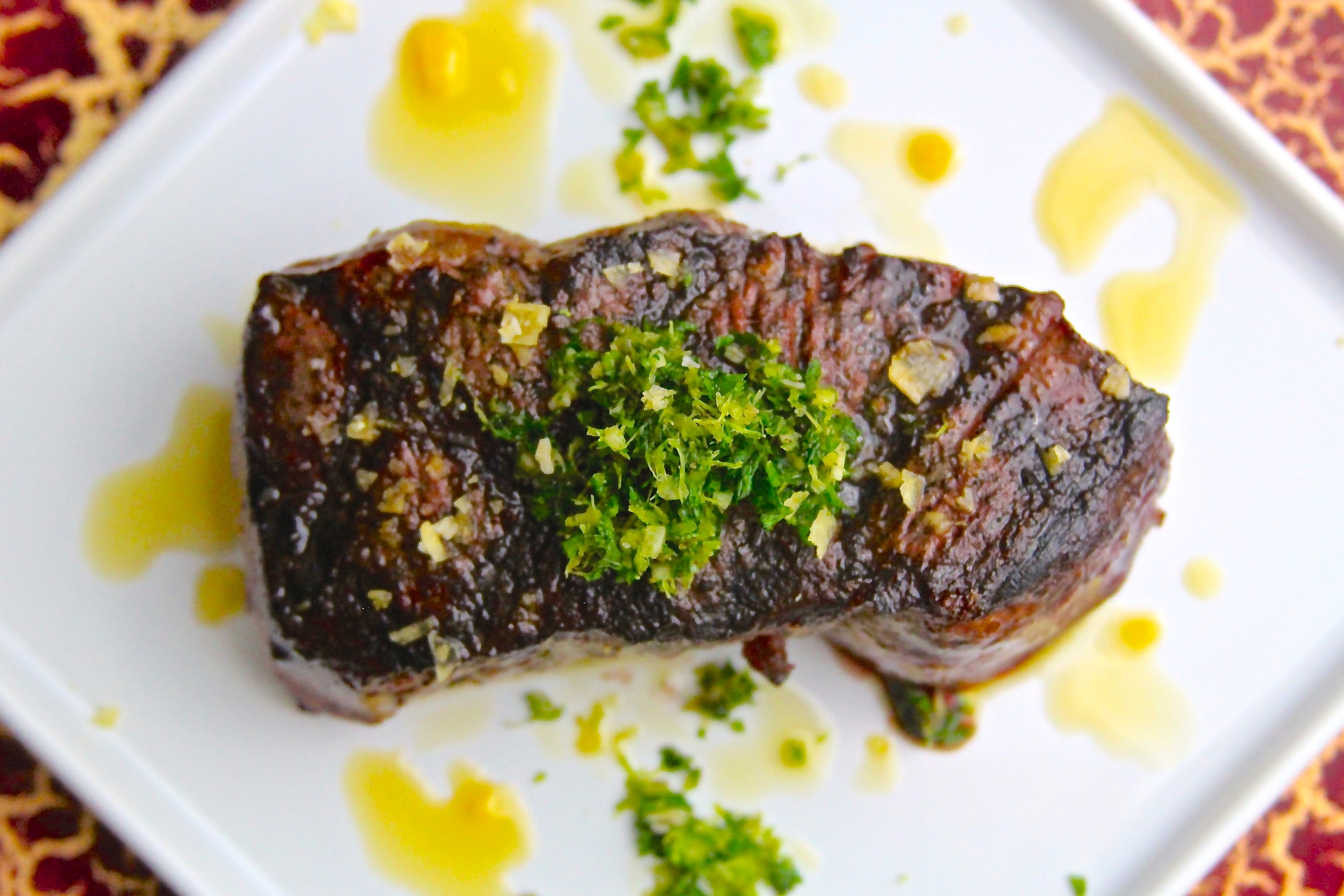 Grilled New York Strip Steak with Gremolata and Chipotle Olive Oil