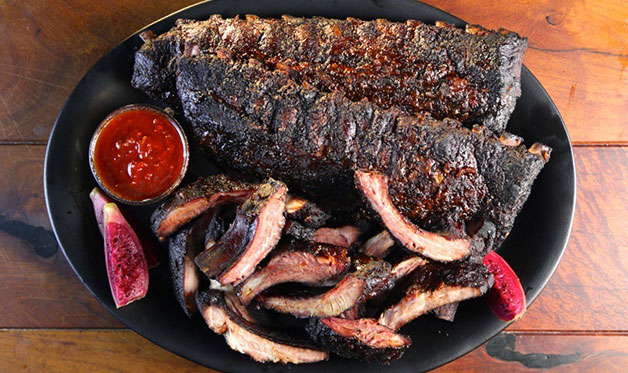 Smoked Baby Back Ribs with Prickly Pear Barbecue Sauce (Photo by Richard Dallett)