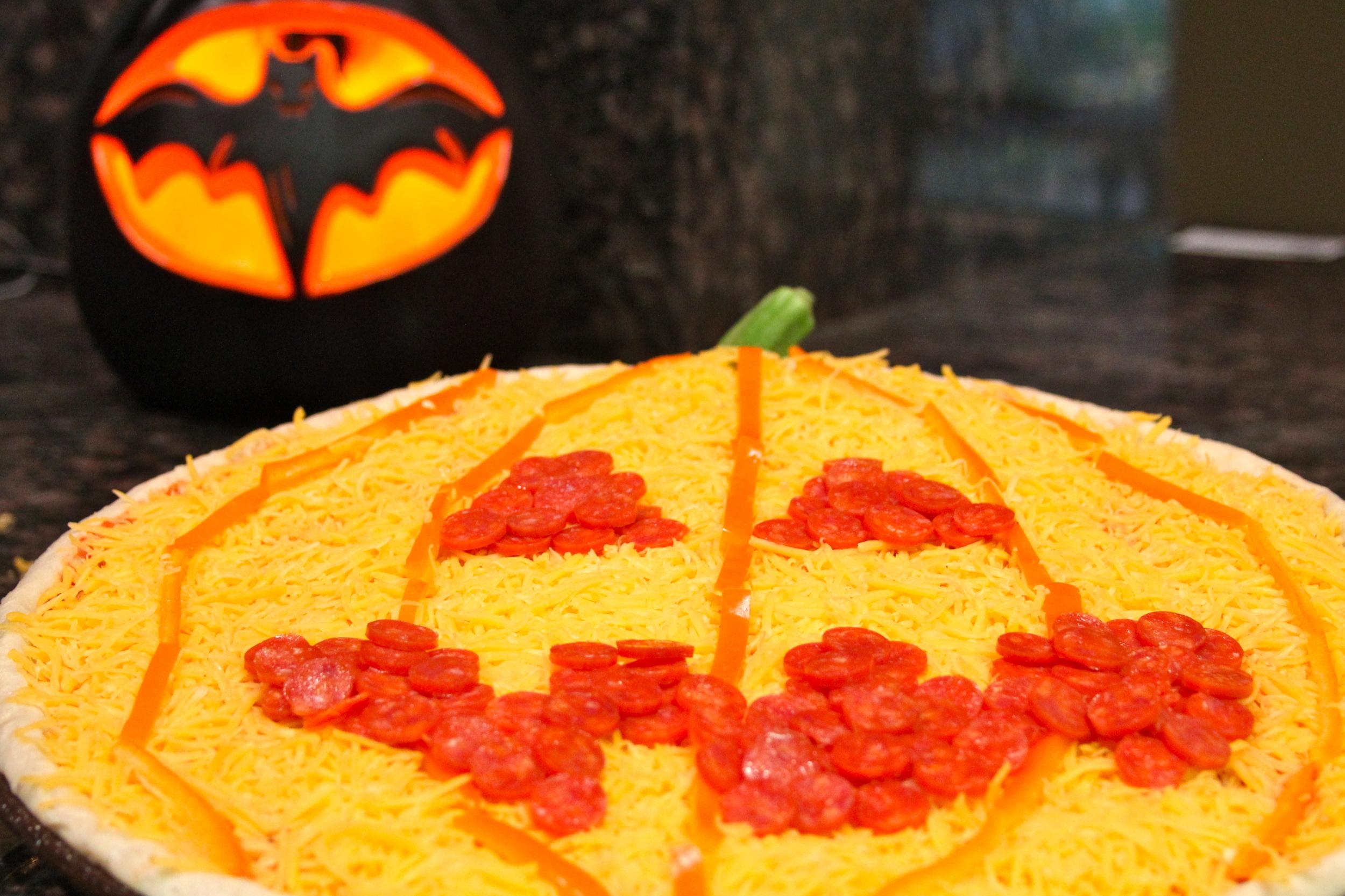 Assembling a Halloween Pumpkin Pizza