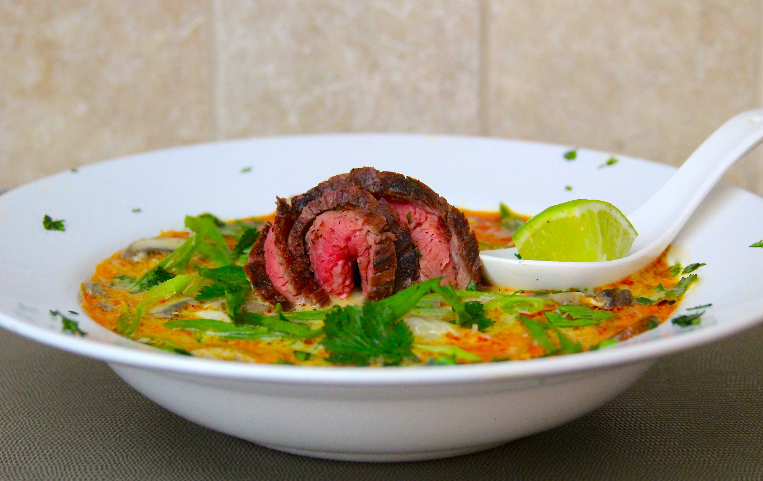 Thai Coconut Curry Soup with Grilled Flank Steak