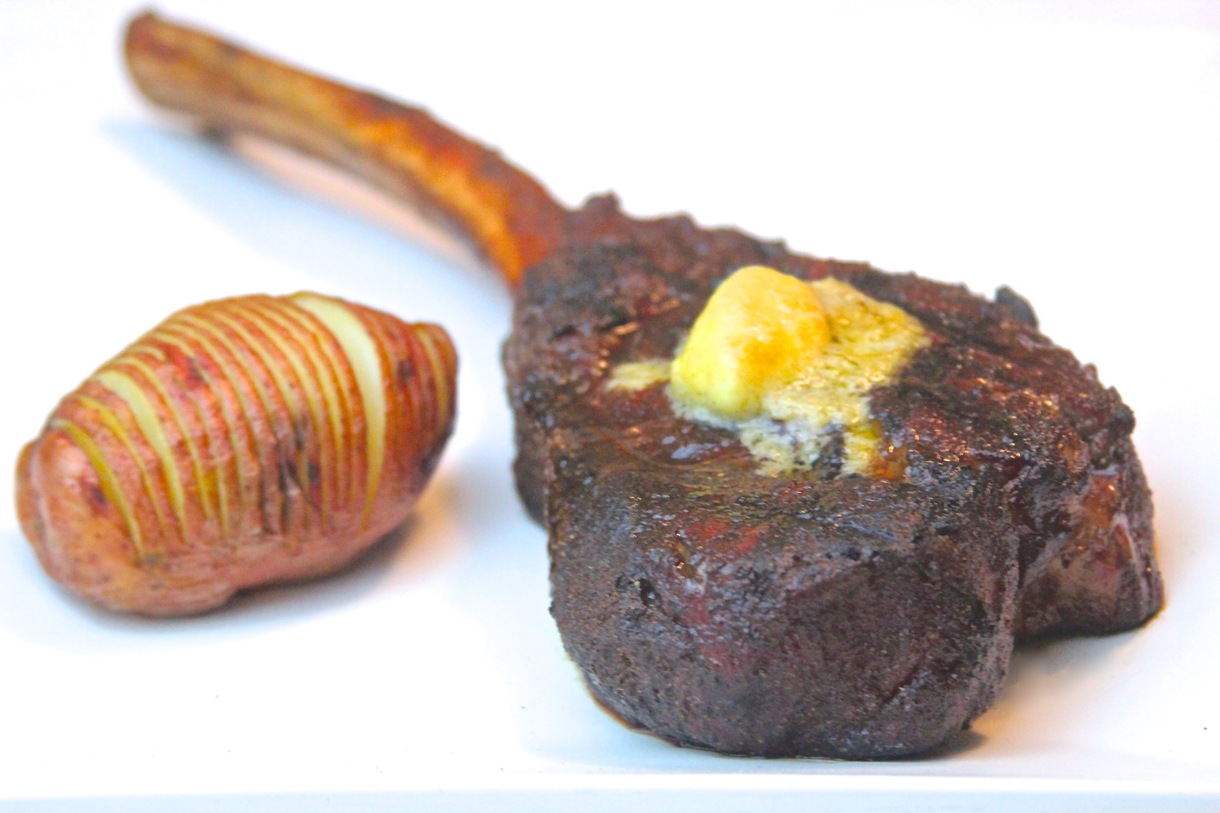 Grilled Tomahawk Ribeye with Roasted Garlic and Horseradish Butter