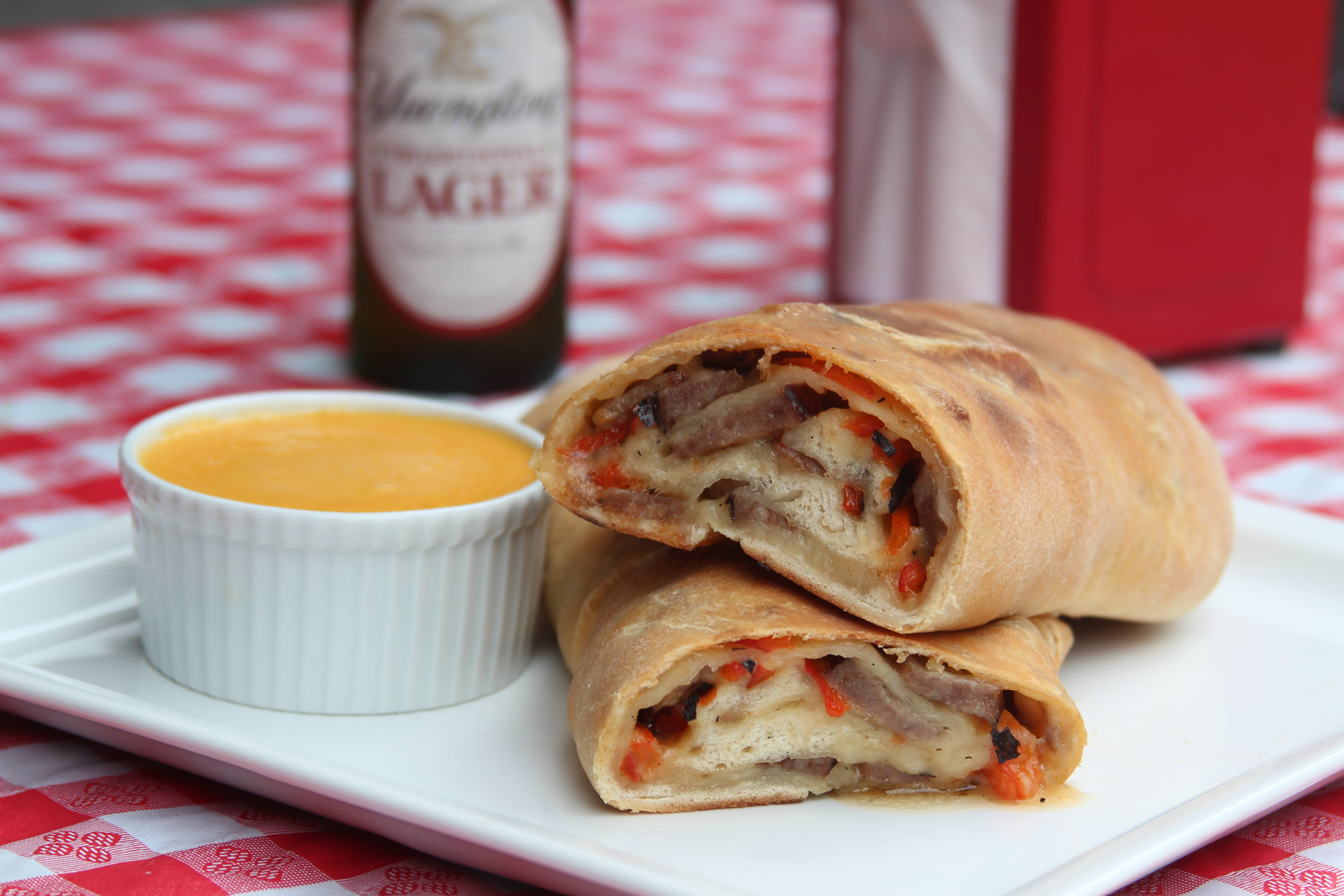 Bratwurst and Charred Pepper Stromboli with Yuengling Lager Cheese Sauce